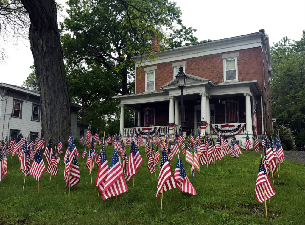 Home in Waterloo, New York with American Flags Display