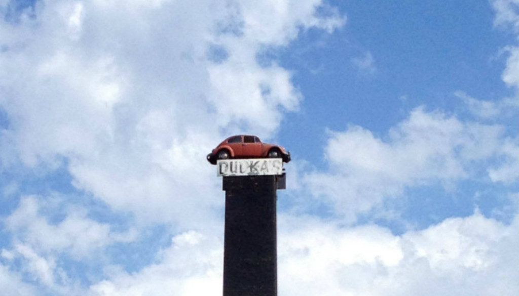Dudka's VW on a Smokestack in Amsterdam, NY - Featured Image