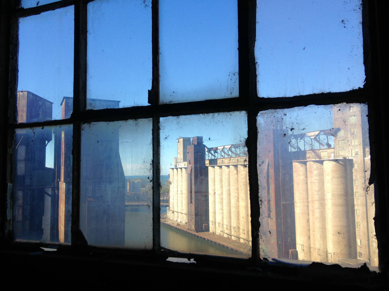 Aerial View of Silo City and Lake Erie through a window in Perot; Buffalo, NY