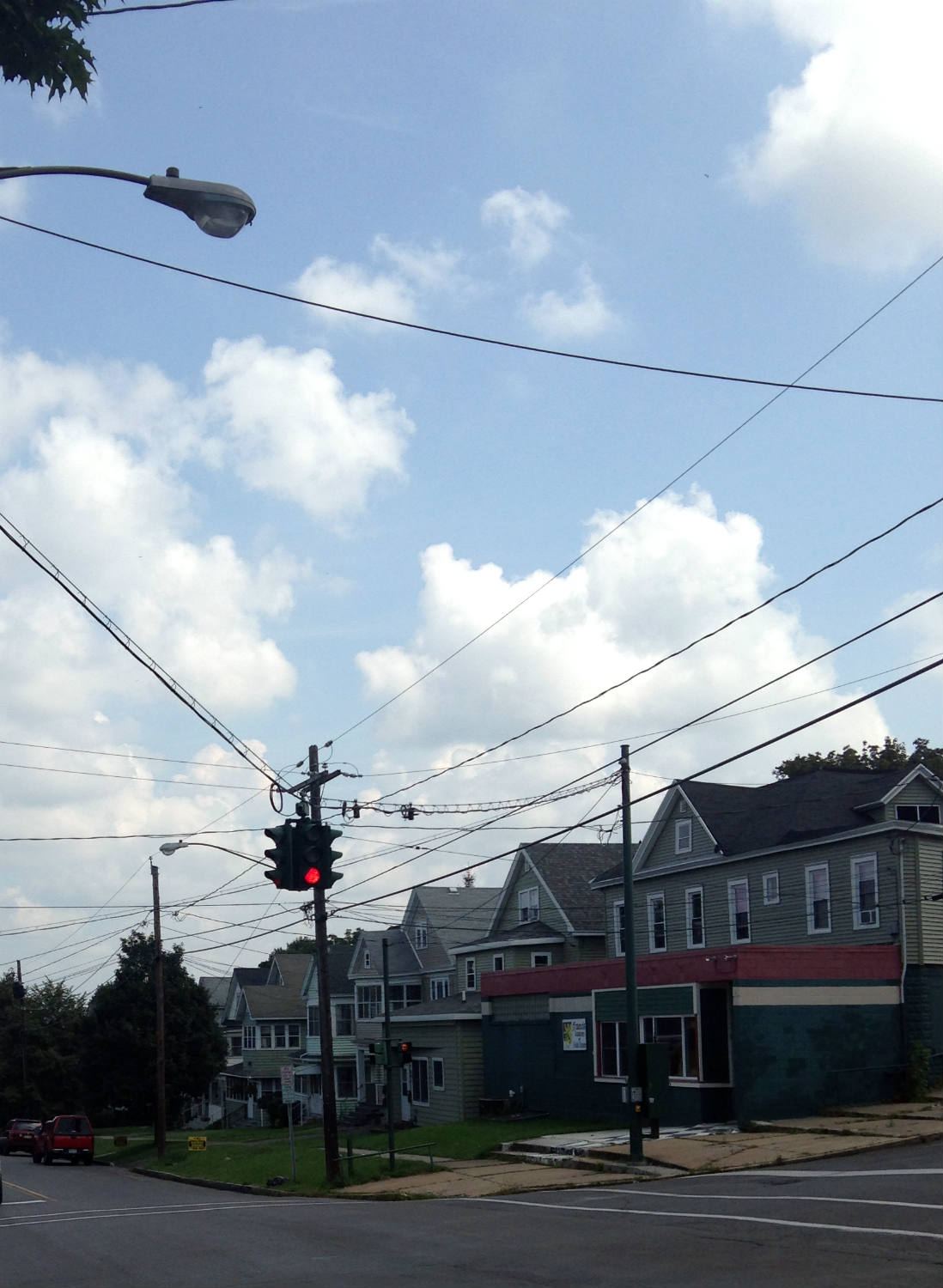 Red on Bottom Traffic Light in Irish Neighborhood