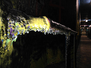 Paint buildup on a railing in the Eastman Quad Tunnel