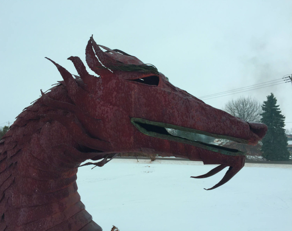Closeup of the head of the metal dragon in East Bethany, NY