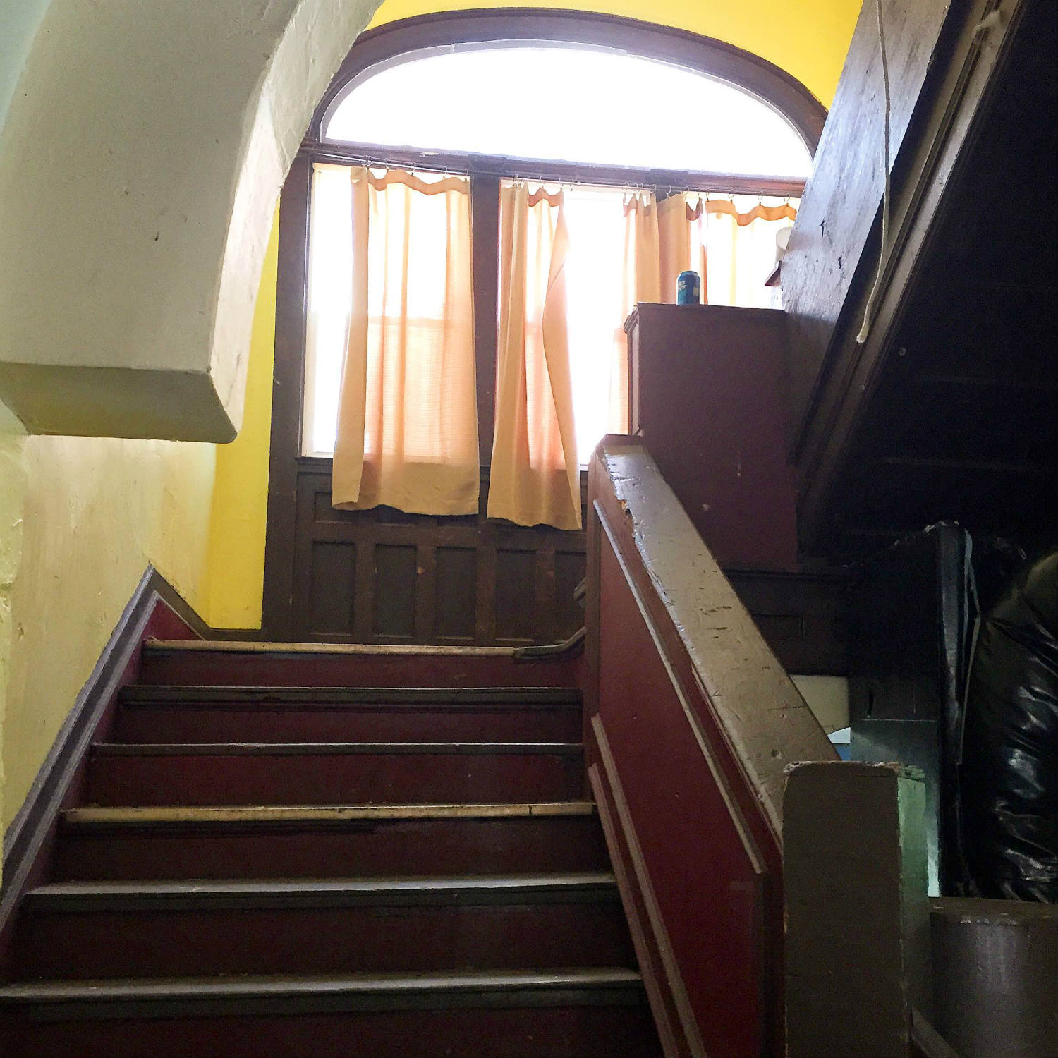 Staircase inside 304 Walnut Place in Syracuse