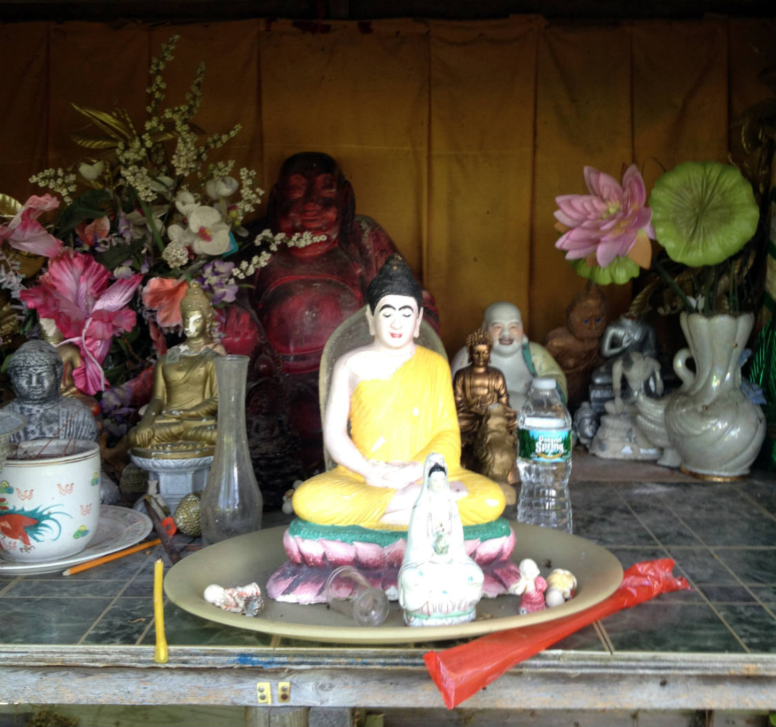 Buddha Shrine on the back property at the Wat Pa Lao Buddhadham in Rush