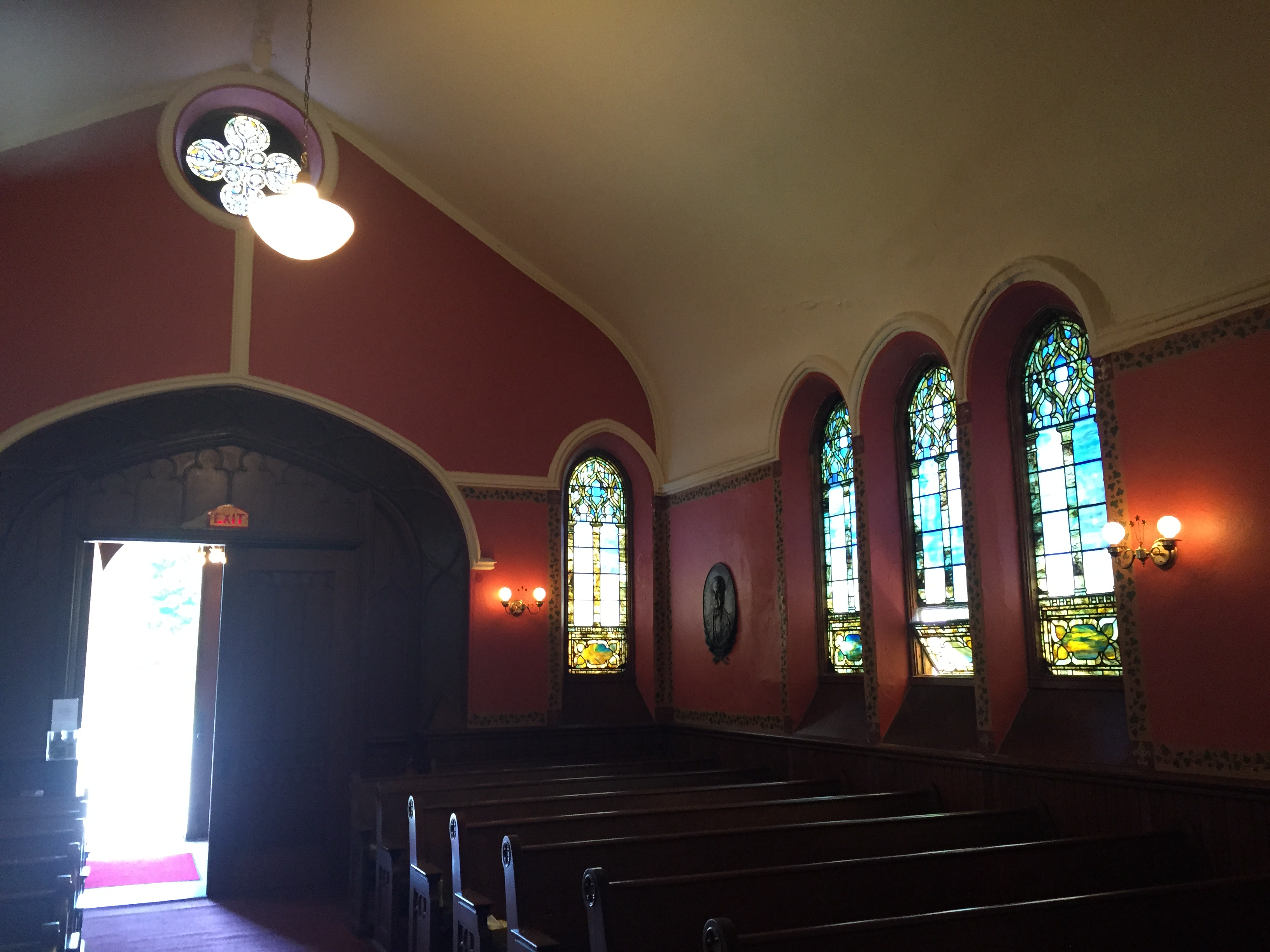 Windows and Pews in the Pullman Memorial Universalist Church in Albion