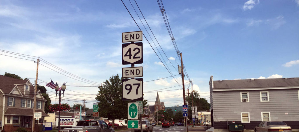 New York State Route 97 signs in Port Jervis, New York