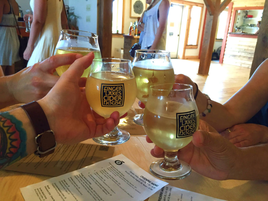 Cheers at Finger Lakes Cider House in Interlaken, New York