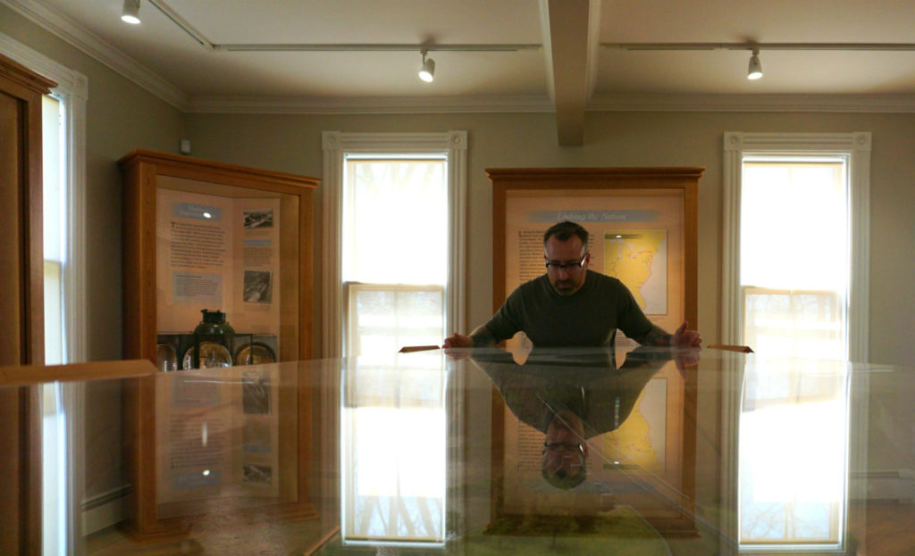 Chris Clemens of Exploring Upstate Viewing the Canal Exhibit at Schoharie Crossing