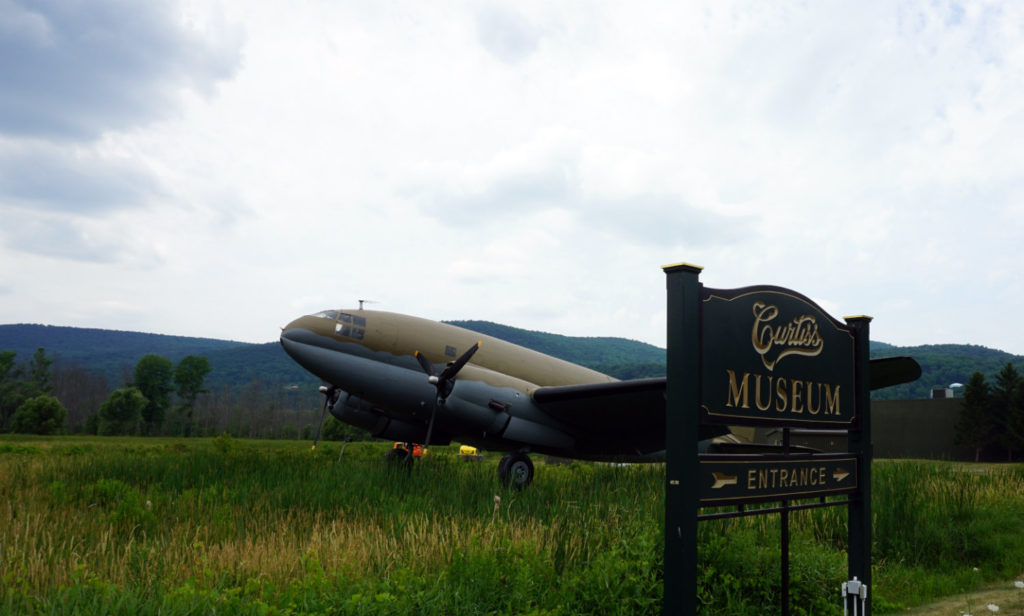 Outside the Curtiss Museum with Welcome Sign