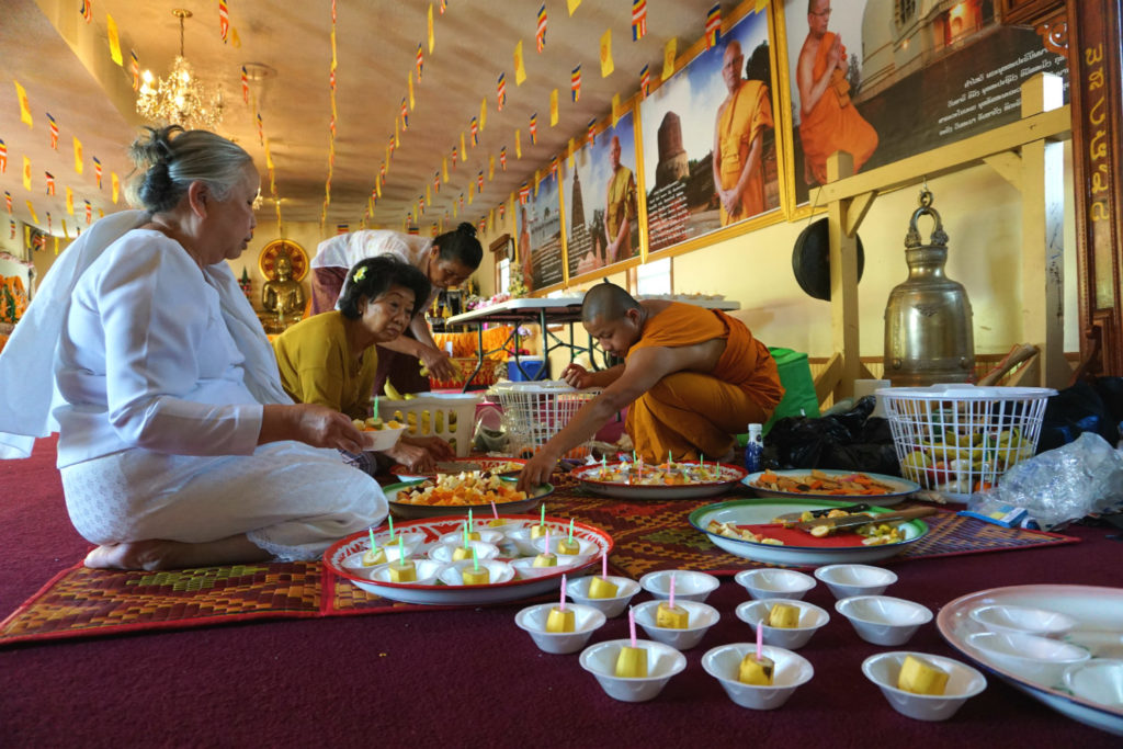 Preparing The Offering at the Wat Pa Lao Buddhadham in Henrietta, New York