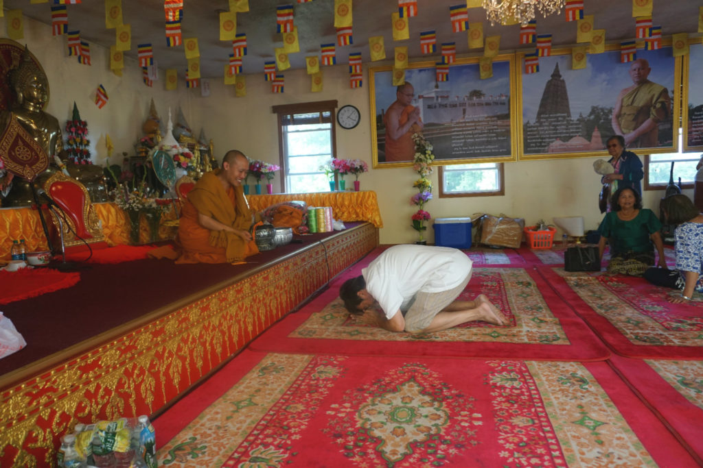 Dennis Allen Receiving A Blessing From A Monk at Wat Pa Lao Buddhadham in Henrietta, New York