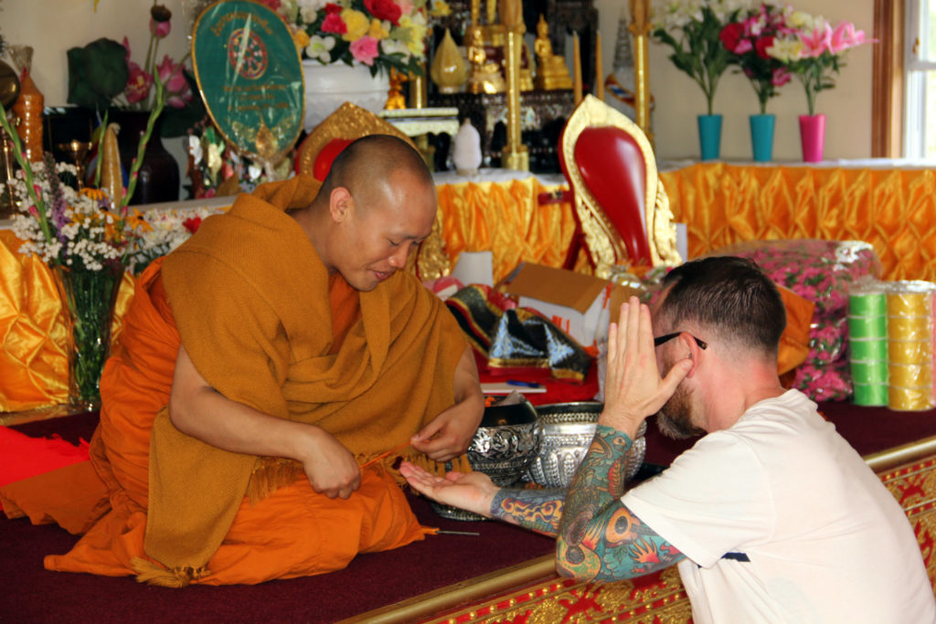 Chris Clemens Receiving A Blessing From Monk At Wat Pa Lao Buddhadham in Henrietta, New York