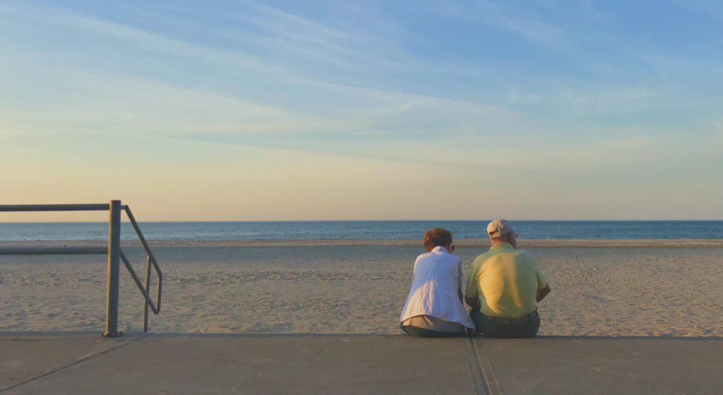Couple Sitting at Charlotte Beach Park on Lake Ontario