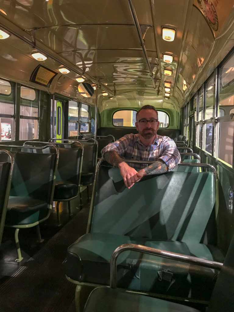 Chris Clemens Sitting on the Rosa Parks Bus at the Henry Ford Museum in Detroit, Michigan