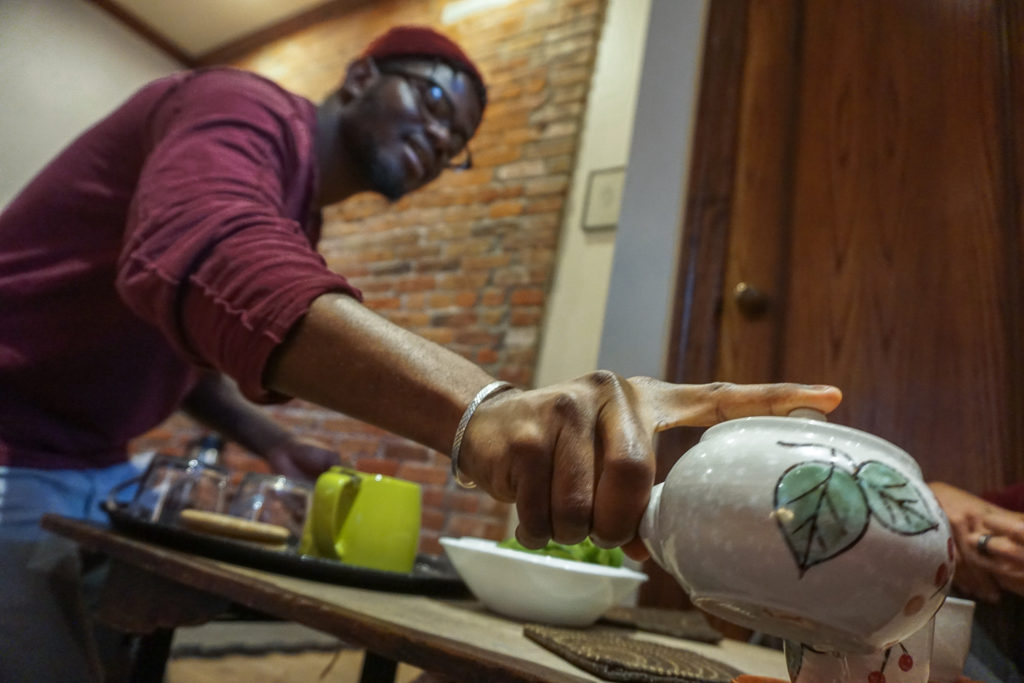 Employee Pouring Tea at the Roji Tea Lounge in Syracuse, New York