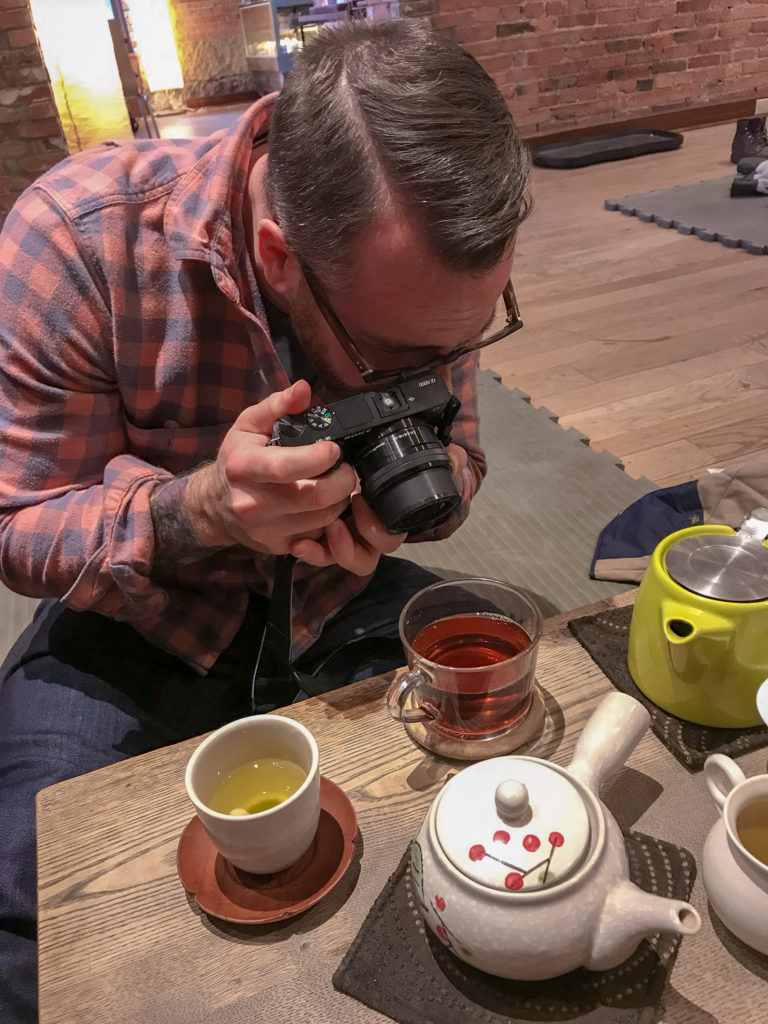 Chris Clemens of Exploring Upstate Photographing Tea at Roji Tea Lounge
