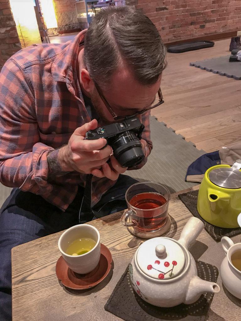 Chris Clemens of Exploring Upstate Photographing Tea at Roji Tea Lounge