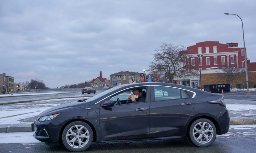 Chris Lindstrom of Food About Town Taking a Photo on Lockport's Big Bridge
