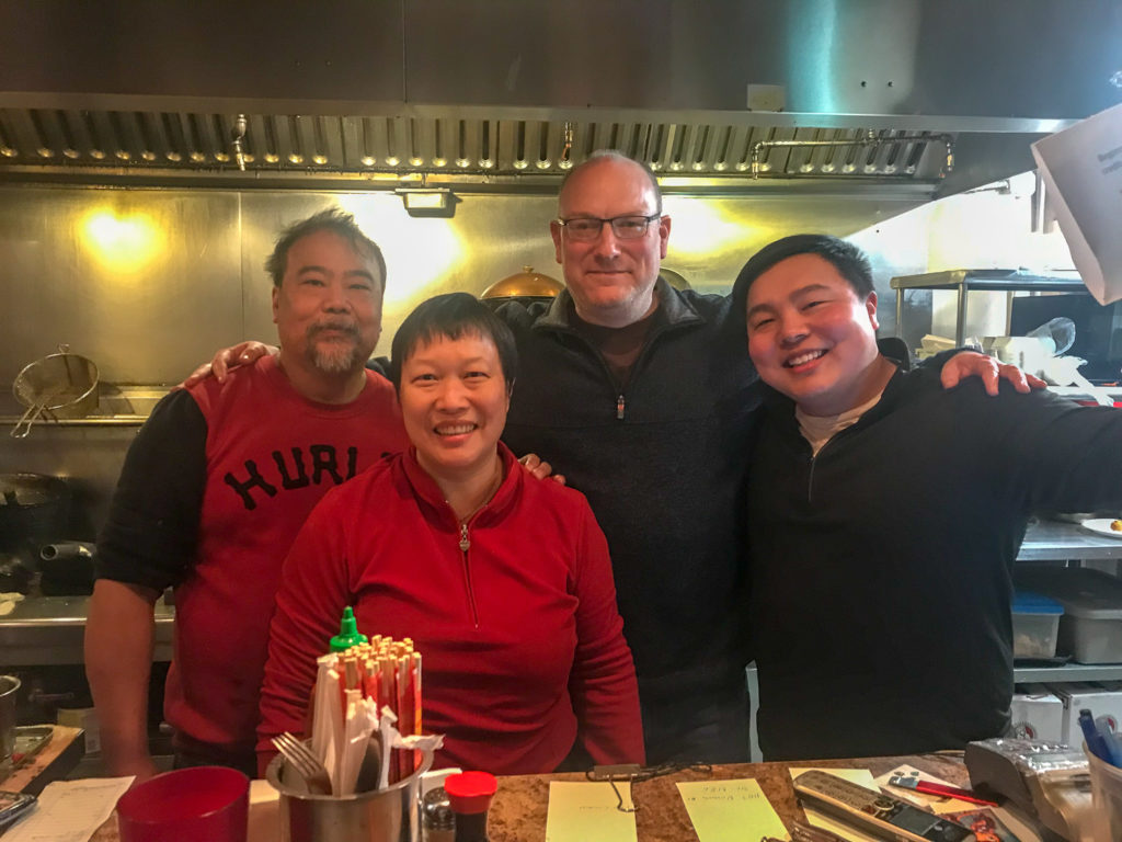 Adam Wilcox with the staff at Ming's Noodles in Rochester